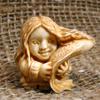 Девочка с рыбой (кость -бивень мамонта)