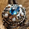 Кольцо с голубым топазом и жемчугом